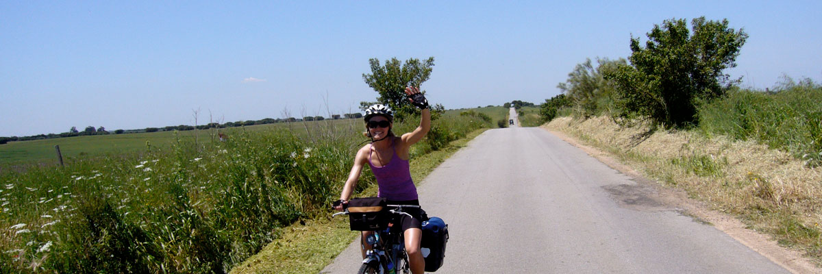 Cheerful cyclist on country side road