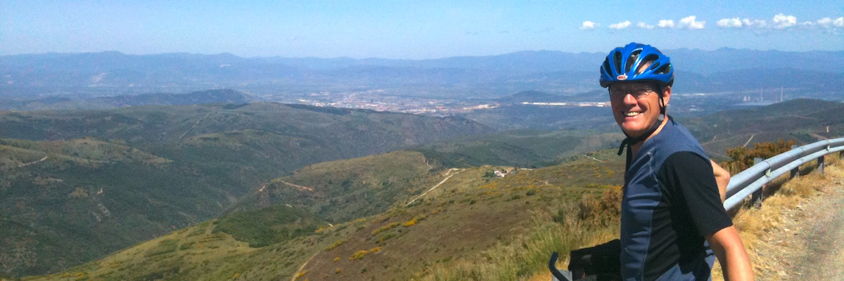 Cyclist overlooking the views from top of the hill in Spain