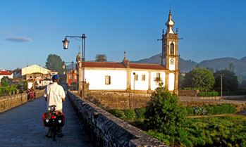 Cyclist in Ponte de Lima medieval bridge