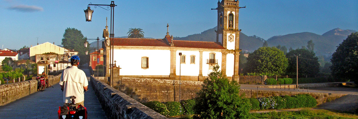 Cyclist observing Ponte de Lima Church on the Camino Portugues