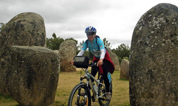 Mountain Biker in Almendres Cromlech in Evora, Portugal