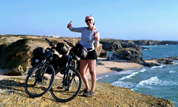 Cyclist on a beach cliff in the Costa Vicentina in Portugal
