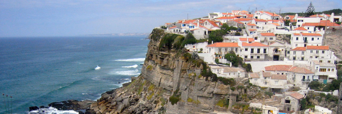 Cliff village overlooking the ocean near Sintra, Portugal