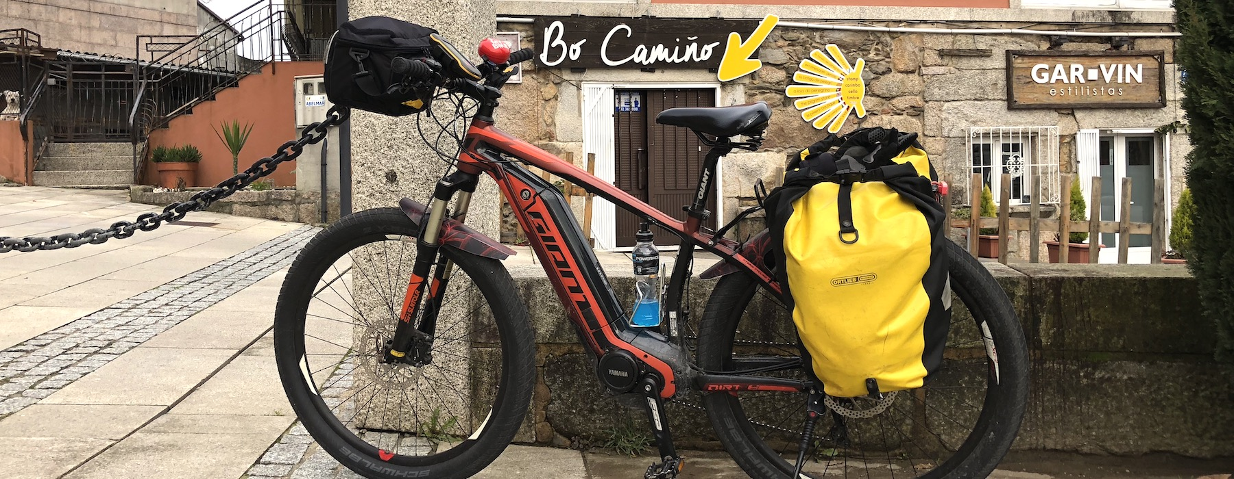 Bike in Camino Santiago with yellow arrow sign