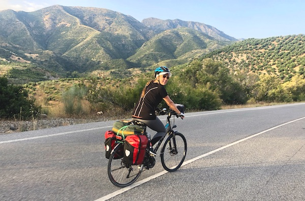 Cyclist in Andalucia Mountains