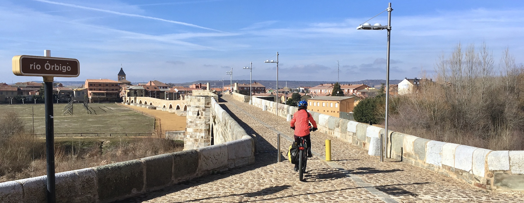 Bike Pilgrim on Orbigo Bridge in Camino Santiago