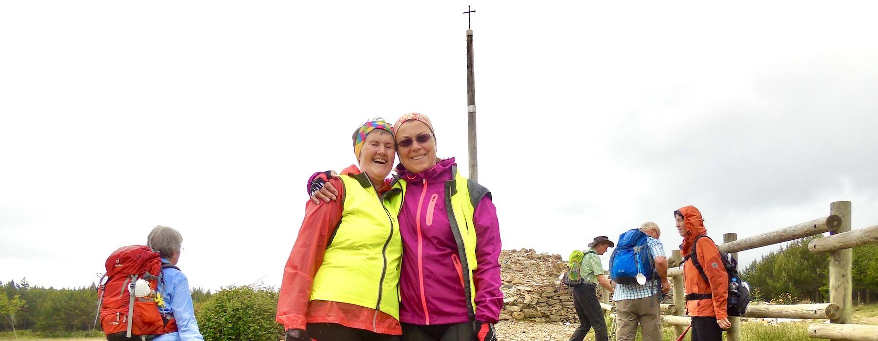Camino Pilgrims in Cruz de Ferro