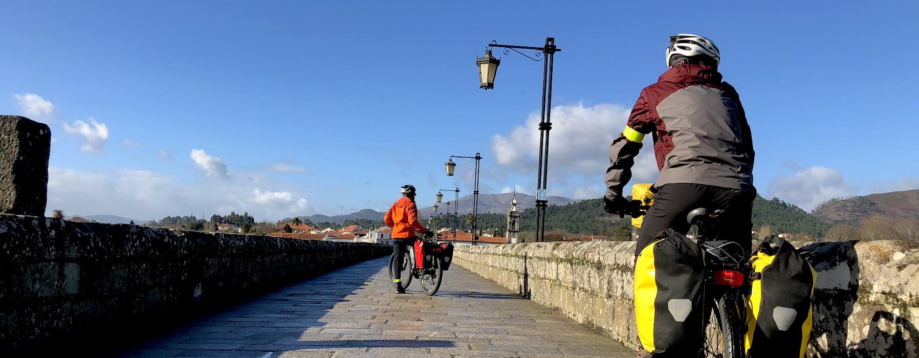 Cyclists on Medieval Bridge Ponte de Lima